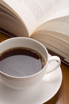 A coffee cup and open book.